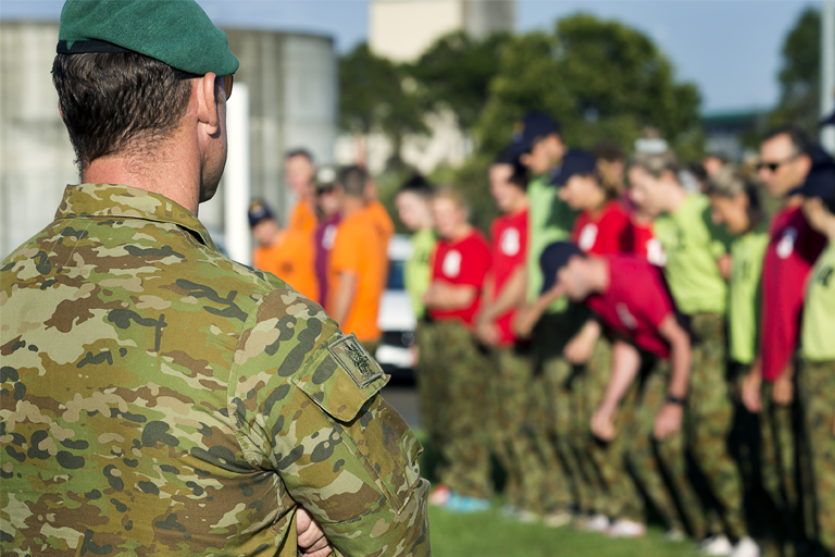 Australian Army soldier puts athletes and coaches through a training session.