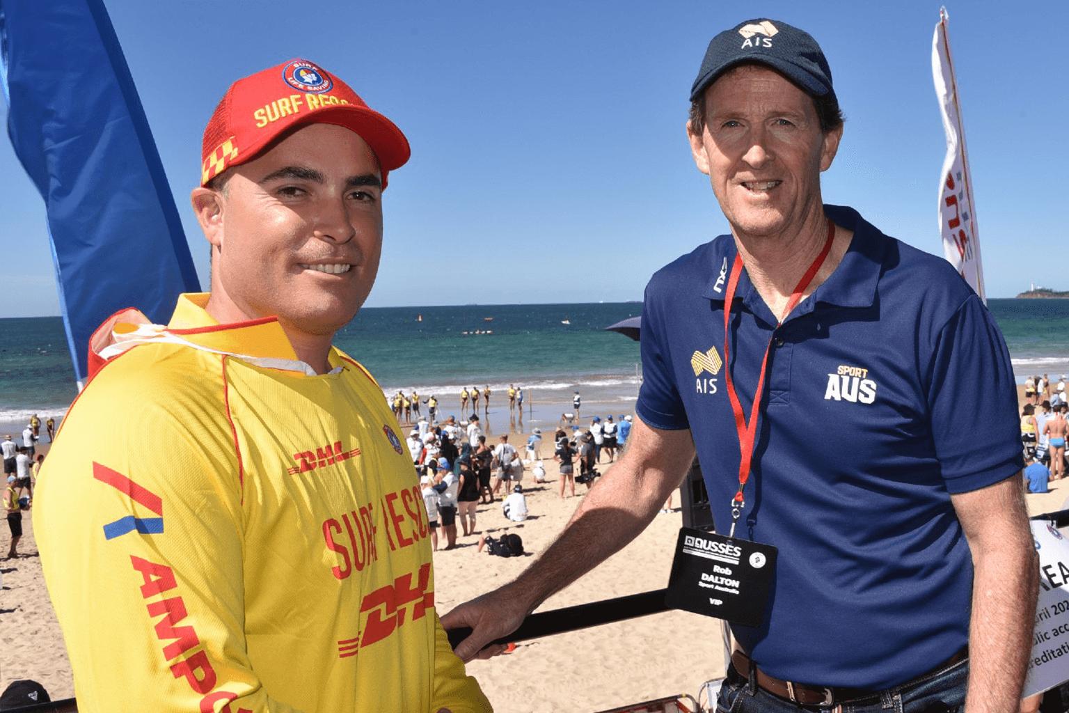 A surf life saving volunteer speaks to Rob Dalton