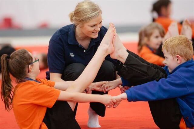 Gymnastics children with coach