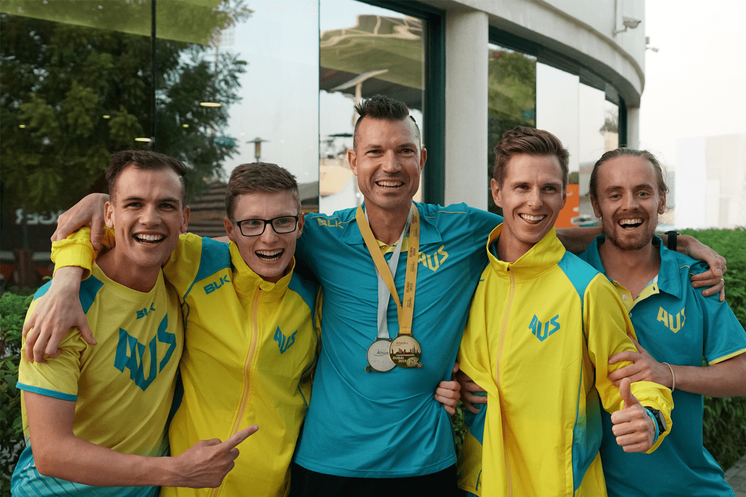 Coach Philo Saunders, centre, with athletes Deon Kenzie, Jaryd Clifford, left, and Michael Roeger and
