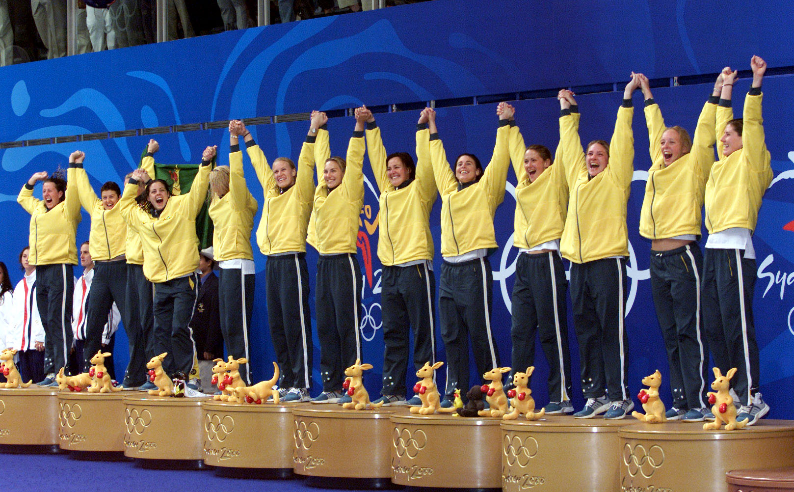 Image of the Australian Women's Water Polo team receiving their gold medal at the Sydney 2000 Olympics.