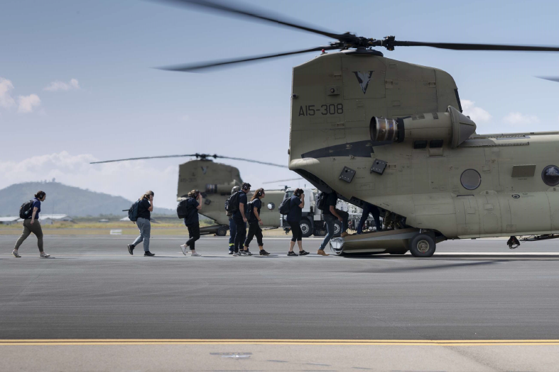 AIS representatives exit an Australian Army CH-47 Chinook on route to Townsville Field Training Area, Queensland.